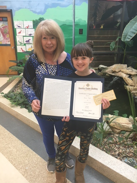 Sharon Hansel, American Legion Unit Education Chair and Claire Rogers, SCES 6th grader